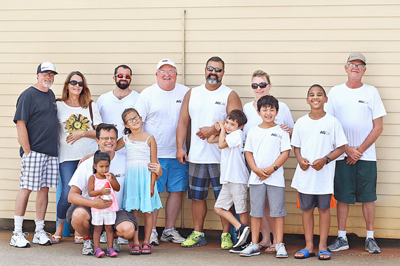 AG|CM team and families at beach cleanup